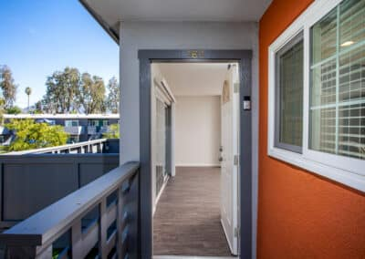 Countrywood Apartment Homes open front door and refreshing balcony view